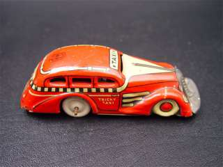 Marx Red Tricky Taxi Tin Windup Toy Table Top Car