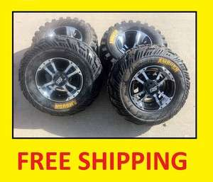 RAPTOR 700 ITP SS112 Black Machine RIMS on CST Ambush Tires Wheels kit