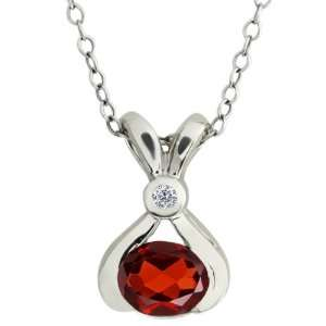 0.93 Ct Oval Red Garnet and White Diamond 10k White Gold